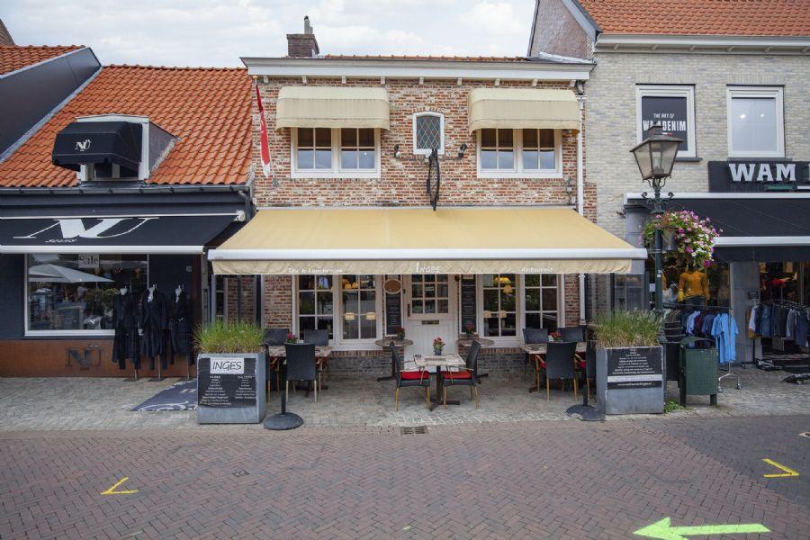 Restaurant met bovenwoning en terras